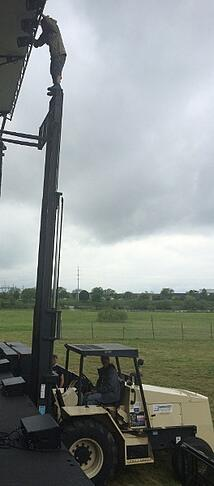 Forklift_Safety_Fail_-_Man_Standing_on_Top_of_Mast-Resize