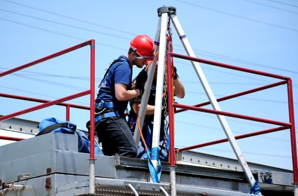 Industrial rescue students performing confined space rescue during training