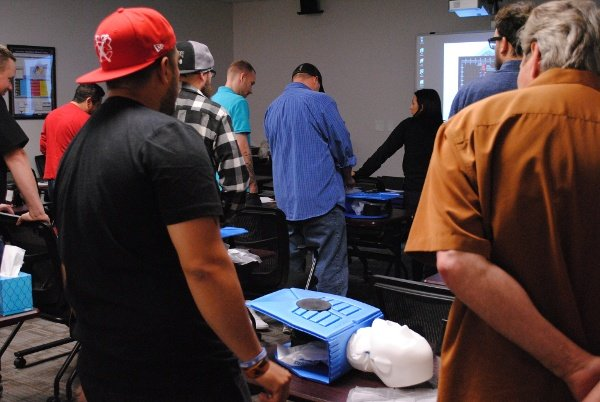 Students performing CPR during first aid training