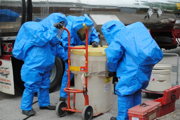 Hazwoper students recover a drum spill during hazmat refresher training
