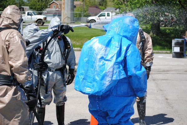 Hazwoper students learn how to properly perform decontamination during training exercises